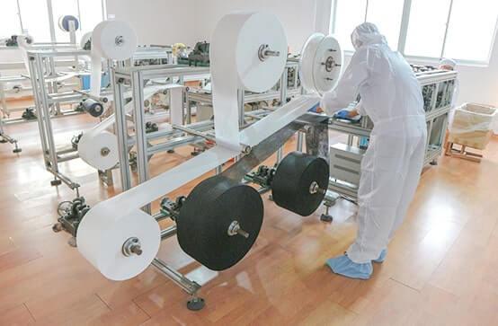 ワークアップ黒マスク工場のマスク製造機械